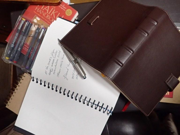 misc. notebooks, pen, books